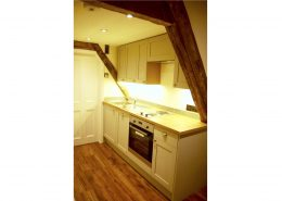 Gallet style kitchen at East Wing apartment, Swafield Hall